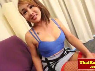 Naughty Thai tgirl in fishnet stockings rubs ass