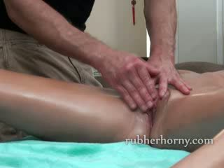 Sexy brunette has her pussy massaged and slowly teased