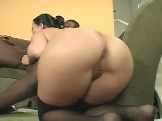 Niya Yu bouncing up and down on a hard black cock