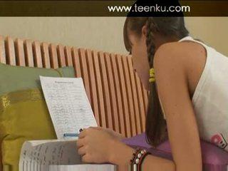 Amateur heet tiener in roze slipjes doing homework