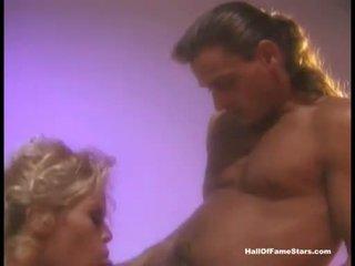 Erotic blonde pornstar Jenna Jameson loves soaking her mans cock in her mouth