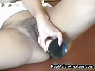 Slutty 亚洲人 grabs 她的 热