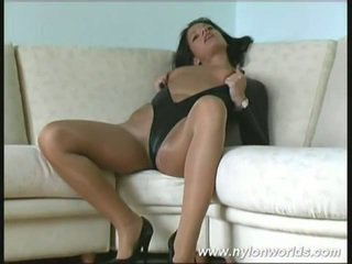 Black Haired Susi Poses Inside Stockings