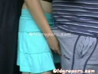 Old man groping woman whith hot body