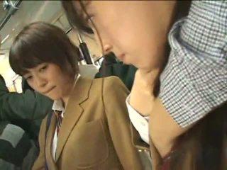 Public perverts harass Japanese schoolgirls on a train
