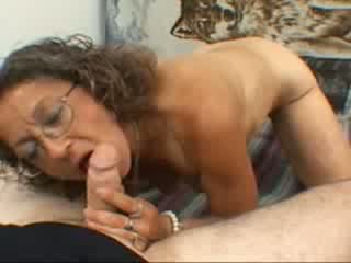 A grandma gives a blowjob