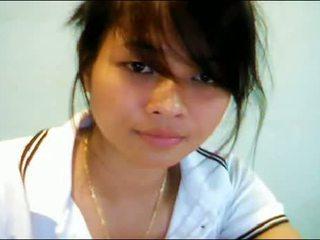 Warga asia remaja pada webcam