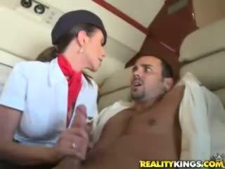 Hot flight attendents Ariella Ferrera and Aimee Addison give in flight blowjob