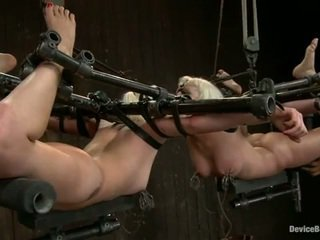 Two whores bonded and eye to eye while tortured