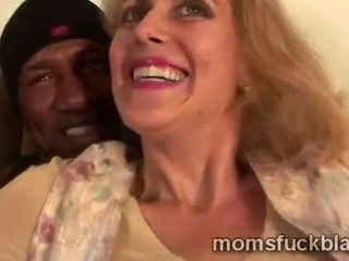 Mature blondie seems very curious for her black lovers tool