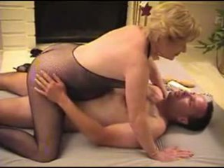 Nice Granny in Fishnet Body Stocking Invited a Younger