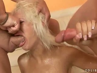 Two guys pissing on sexy blonde