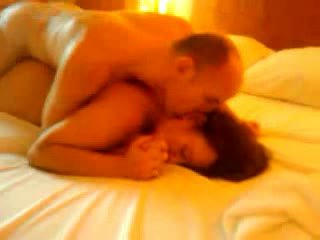Couple enjoy a hot fuck on the bed while someone watches Video