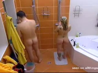 Shaves-his-junk-whle-naked-girl-looks-on