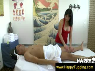 Asian masseuse giving a warm welcome to a client