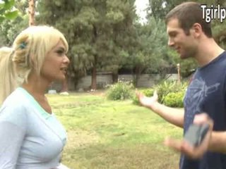 Sexy blonde tgirl Kim Bella invites a guy over to the bedroom