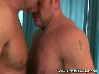 Mature stud seduces a gay by showing off
