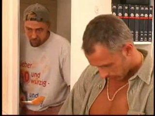 Pierced and tattooed German slut taking on two cocks