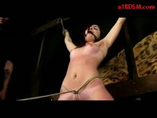 Girl With Tied Legs And Arms Getting Her Tits Rubbed Whipped Tortured With Stick By Master In The Dungeon