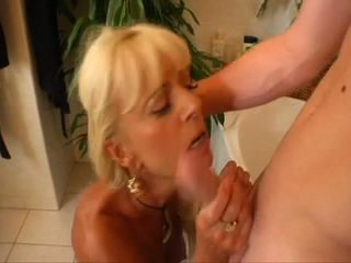 Blond MILF Eats Young Guy's Ass in Bathtub
