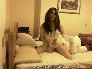 Horny crossdresser Kirsty wanks her big cock in sexy virgin white lingerie