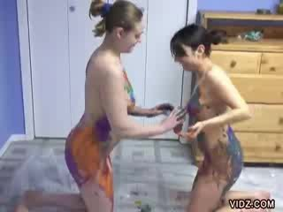 Two chick sluts enjoy fucking with paint