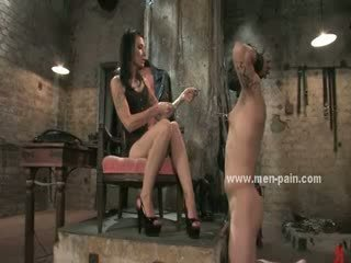 Sadomaso mistress in short robe using cellar and alive sex toy to please her sick wild fantasies