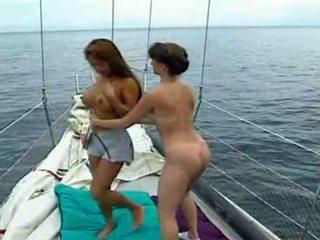 Busty lesbian pleasures on sailing yacht