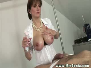 Mature domina wants him hard whille she strokes him
