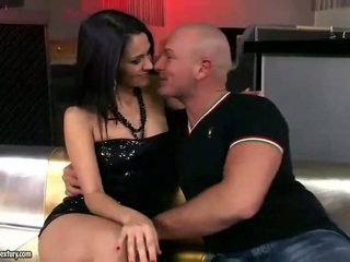 Hot brunette riding two cocks