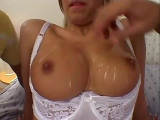 Gabina Czech with perfect body oils up her tits and takes a DP
