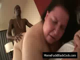 Brunette old slut blows black dick and is fucked doggystyle