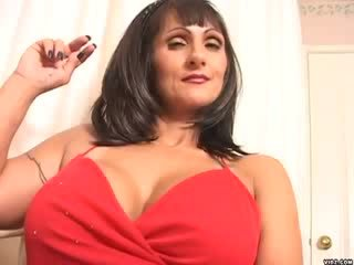 Horny Corina smokes while caressing her puss