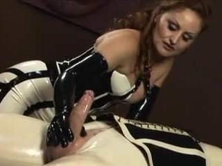 Redhead in latex shaves masked shemale's balls