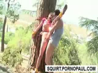 Tied to a tree till she squirts from pussy