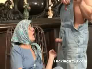 Horny granny fingers herself and gives soaking wet blowjob
