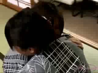 2 asians In Kimonos Kissing One Of Them Getting Her Nipples Sucked On The Floor In The Room
