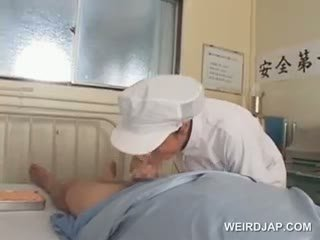 Asian Nurses Rubbing Their Patients Hungry Shafts