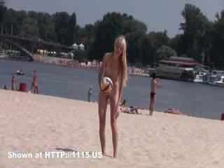 Two skinny nudist babes frolic around the beach