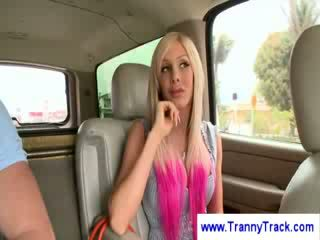 Blonde tranny shows her sillicone tits