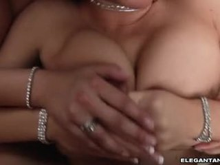 Hawt boodaybed krissy lynn squeezes a meaty jago between her boobs til it cums