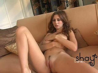 Natural boobed Shay Laren spreads her pink pussy on the couch