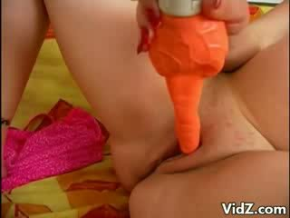 Pregnant Blonde chick satisfies fur with toy