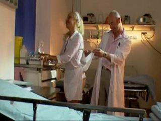 Blonde Nurse In Black Stockings In Room - Dorcel