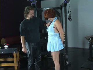 Hot redhead is restrained with red ropes and has her bokong spanked hard