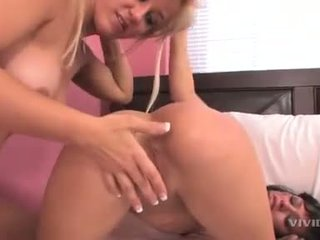 Lesbians Ashely Ryan and Sadie West getting raunchy with each others pussies
