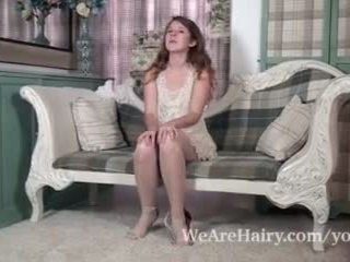 Jada is playful and seksual as she strips on chair