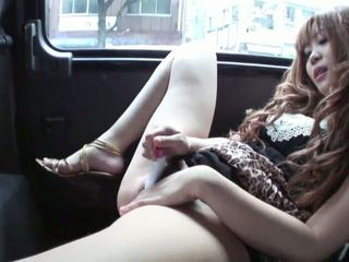Horny cutie masturbates in the back seat of a car