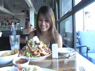 hot brunette girl eating
