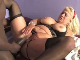 Mature blonde in black stockings gets rammed by black bazooka